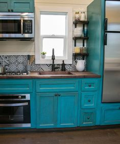 Archway Tiny Home by Tiny Heirloom The kitchen features beautiful blue cabinetry, a six-foot walnut butcher block countertop, Moroccan tile backsplash, and full-size appliances. Remodeling Mobile Homes, Home Remodeling, Mobile Home Makeovers, Tiny Houses For Sale, Tiny House Living, Kitchen Countertops, Home Builders, New Kitchen, Kitchen Ideas