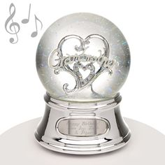 "Musical Water Globe - Grandmother - Since your Grandmother is a special person in your life this is a great way to celebrate her. She'll love that it plays the song ""Tennessee Waltz"" when wound up. This snowglobe is sure to delight your Grandma. We suggest adding a personalized engraved message so she remembers who gifted her this perfect snowglobe for years to come!"