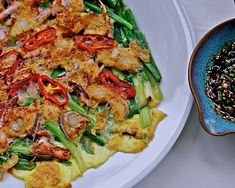 korean seafood pancake - a little different bc eggs are poured over it, instead of mixed in with batter.