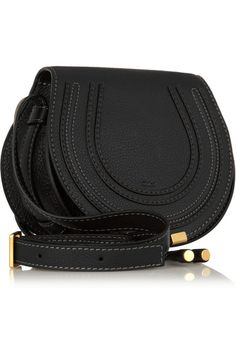 Black textured-leather (Calf) Tab-fastening front flap Comes with dust bag Weighs approximately 1.3lbs/ 0.6kg