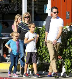 Reese Witherspoon, wearing a festive sweater, and husband Jim Toth step out with their beautiful family.