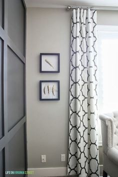 Gorgeous DIY curtain panels and DIY board and batten grid wall. Love this look!