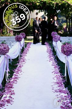 Edge the aisle in rose petals for a glamorous pop of color.