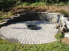 Cutting into the hillside made room for this patio and fire pit ...