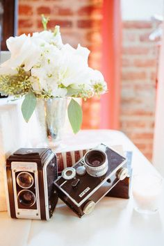 Vintage Cameras at a wedding for guests to take pictures......AWESOME idea!