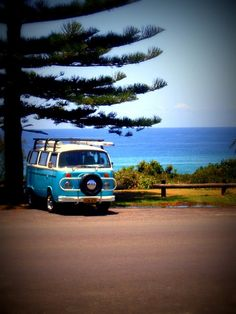 Beautiful image of an old school surf van sitting by the sea.
