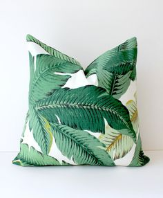 17 Ways To Introduce Botanical Design Into Your Home Decor | Add a statement pillow to your couch collection with these tropical leaf pillows that bring color, comfort and botanicals into your home.