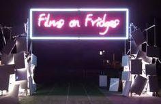 Films on fridges. Film screening on pile of discarded fridges in East London, in memory of a fridge mountain