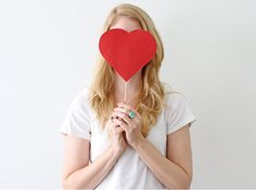 Heart Photo Stick: These photo props are a wallet-friendly way to dress up your home photos for Valentine's Day and throughout the year.
