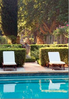 What a setting for this gorgeous pool, loungers & armillary sphere in the background.
