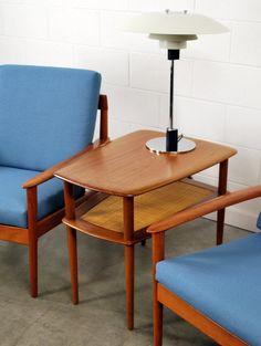 Solid teak two-tiered end table with caned shelf. Designed by Peter Hvidt & Orla Mölgaard-Nielsen.