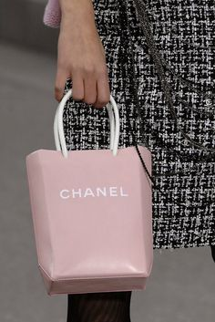 """The Season: Spring 2009 The Accessory: Sweet logo-laden leather """"shopping bags"""""""