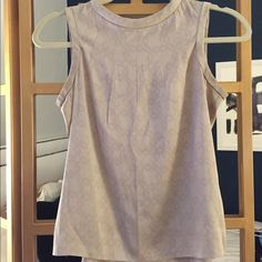 Silk high-neck tank with print detail Great basic - stretch silk is super comfortable. Excellent condition - just have not worn in a while. Looks great with pencil skirts or dressed-down. Banana Republic Tops Blouses