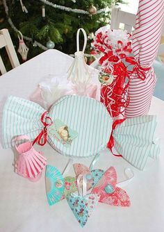 IMAGE ONLY - Gift wrapping - GREAT IDEA for neighbor's gift---Make a large cookie---wrap in saran and then cover w/Christmas wrap and twist the ends