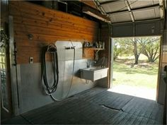 Wash rack in horse barn with stainless steel walls, hot and cold water 2 floor drains. Wash rack in horse barn with stainless steel walls, hot and cold water 2 floor drains.
