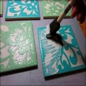 Can't find coasters you actually like? Mod Podge your favorite scrapbook paper onto tiles.