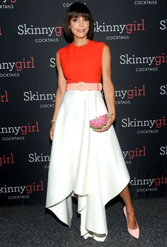 Bethenny Frankel in an orange-and-white color block dress, Judith Lieber watermelon clutch and pink pumps