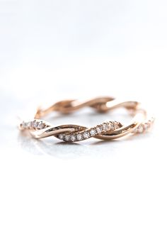 The two metal strands of this intricate band gracefully intertwine' one smooth and shining, one encrusted ...