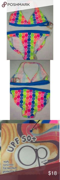 Bikini Bathing Suit Sun Protection Swim 14/16 New This adorable girls polka dot two piece bathing Suit is brand new with tag. The size is extra large 14-16. It has sun protection made into the fabric.  My home is smoke free and pet free.  I am a very fast shipper.  Be sure to check out the other items in my closet to bundle for your discount.  I consider all offers.  Happy POSHING!! Op Swim Bikinis