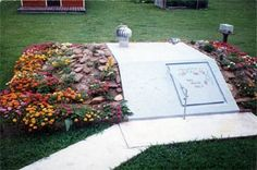 Storm shelter with flower garden.