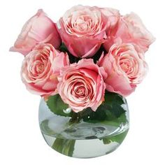 "Highlighted by elegant faux rose blossoms nestled in a clear glass vase, this beautiful floral arrangement adds a hint of romance to your decor.  Product: Faux floral arrangementConstruction Material: Art silk, acrylic, and glassColor: PinkDimensions: 9"" H x 10"" Diameter"