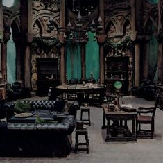 Cool Dark Gothic Livingroom With Vintage Furniture And Black Leather Sofa And Gothic Hanging Lamps