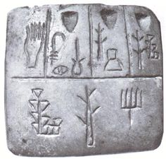 Sumerian cuneiform, one of the earliest known writing system. Its origins can be traced back to about 8,000 BC. It developed from the pictographs and other symbols used to represent trade goods and livestock on clay tablets. Sumerian was spoken in Sumer in southern Mesopotamia from perhaps the 4th millennium BC until about 2,000 BC, when it was replaced by Akkadian as a spoken language.  Sumerian is not related to any other known language so is classified as a language isolate.