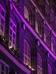 The effects of uplighting in color. Love this elegant deep purple for the facade of a structure.