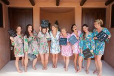 bridesmaids in plum pretty sugar robes sporting signs of how they first met the Bride | Photography by jenphilips.com | Robes by http://store.plumprettysugar.com/  Read more - http://www.stylemepretty.com/2013/08/02/punta-de-mita-wedding-from-the-dazzling-details/