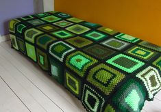 This green bedspread is the perfect size for a single bed or for two to snuggle under on the sofa.