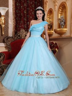 Fashionable Light Blue Quinceanera Dress One Shoulder Tulle Ruch  A-line http://www.fashionos.com You'll feel like a queen in this one shoulder dress with ruffled layers of tulle on the skirt below a form fitting beaded straight bustline with dropped waist embellished with a satin bow.The one shoulder dress has feathered accents on shoulder and a tulle overlay over the skirt. You will be the most beautiful mermaid princess under the spotlight!