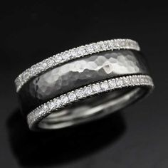 This textured Hammered Wedding Band is framed on either side with diamond bands.