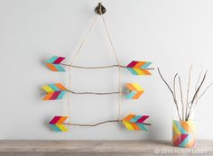 Chevron felt met rustic branches and jute—and fell in love! First, coat sheets of felt with découpage medium. When the felt is dry, cut out your shapes. Then just forage for branches in the backyard (or our Floral Dept.), and hot glue the arrow shapes to the ends. Finish off by tying the arrows to a length of jute.