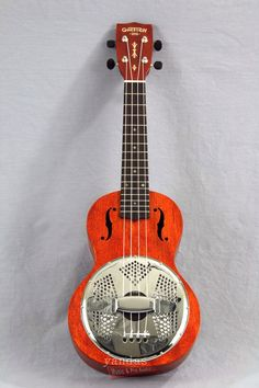 "The Gretsch G9112 Resonator ukulele packs a powerful punch with it's 6"" ""Biscuit"" resonator cone! If you are tired of not being heard, cry no more, this concert size uke is guaranteed to cut through a"