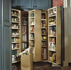 Built-In Pantry Storage:       Tall cabinet doors open to reveal multiple layers of shelving units in this well-stocked, built-in pantry. Shelves are shallow to keep items within easy reach. ~ Wish I could afford this; my pantry doesn't function as well as I'd like.