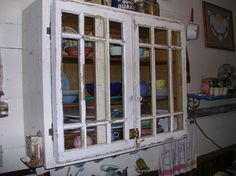 This cabinet was made out of old windows.  Check this site out.  I am going to Habitat for Humanity and buying up all their old windows because there is so much you can make from using old windows as a starting point!!