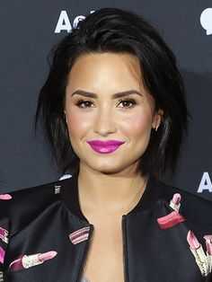 MONDAY Demi Lovato's hot-pink lips will brighten your tired, beginning-of-the-week face. (Unrelated: We need this bomber jacket.)   Photo: Jerritt Clark/WireImage