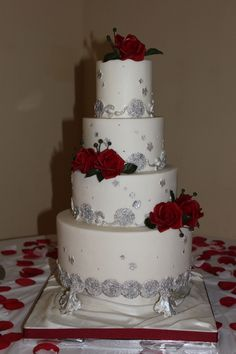 White Cake with Silver & Red Accents
