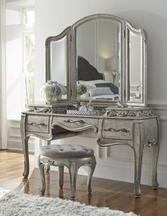 Features:  -Beveled mirror.  -Wooden mirror supports.  -Tri-fold design.  -Stool and vanity desk not included.  Shape: -Arch/Crowned top.  Style: -Contemporary.  Mirror Type: -Bathroom / Vanity mirror