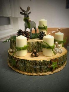 Get some amazing ideas on Christmas candle decorations. We have all you need to inspire yourself and create some gorgeous candle centerpieces. Christmas Candle Centerpieces, Christmas Candles, Centerpiece Decorations, Rustic Christmas, Xmas Decorations, Simple Christmas, Winter Christmas, Christmas Home, Christmas Wreaths