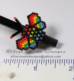 Black and rainbow butterfly peyote stitch dreadlock bead sleeve created by Silver Snake Designs. Email silversnakedesigns@yahoo.com if you would like custom beaded jewelry made!
