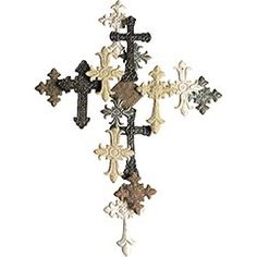 "Cross Collage Wall Décor  Clearance $29.98  Orig. $39.95    Our majestic oversize cross is made up of 14 smaller crosses in various earth tones, sizes and styles. Yet it weighs less than 3 lbs, so hanging is simple. As a symbol of faith or a dramatic design element, it's a bold focal point for any room.   Size: 29""W x 2""D x 40.25""H"