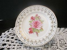 Antique Bavaria Pink Rose Pierced Edge Decorator Plate   My plate has ten small red roses cascading across the plate, rim of plate is the same...........Marilyn