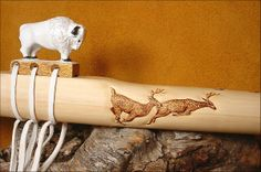 White Buffalo Native American flute with running deer tail on body of instrument by artist, Charles Littleleaf. Available by commission, in all keys and ranges. Please send inquires to artist:  littleleafflutes@gmail.com or call 541.410.7803