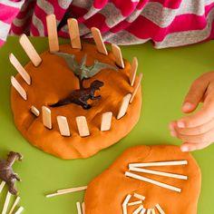 Playdough + dino or animal toys + popsicle sticks