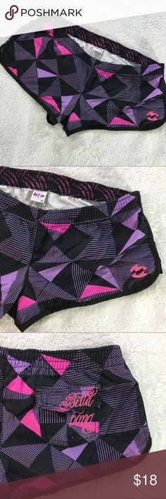 "Super cute Billabong Board Shorts - Size M Size medium - bright and fun board shorts by Billabong. Great black, pink, and purple design.  Strong Velcro small back pocket. Especially great on hourglass and pear shaped figures. Approx measurements when laying flat are 16"" across the waist (doubles to 32""). Great for beach, boating, surfing, or just hanging around the pier. Billabong Shorts"