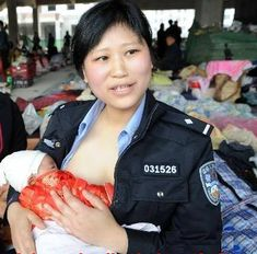 "Twenty-nine year old police officer, Jiang Xiaojuan, left her six month old baby with her mother to take part in disaster relief efforts, after the 2008 earthquake.  Xiaojaun breastfed nine babies during her relief work and was nicknamed ""The police mom""."