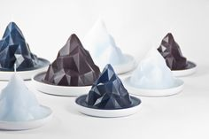 Gentle Giants Studio designed a collection of candles that reflect the icebergs that are melting away called BERGY BIT. http://design-milk.com/bergy-bit-candles-represent-global-warming/