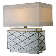 Mirrored base with crisscrossed beveled grooves.