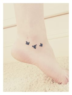 "Bird Tattoo below the ankle for Matthew 6: ""Do Not Worry"" | Atlas Tattoo in Portland, OR #3birds #ankletattoo #sparrow"